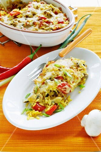 Spicy baked rice with peppers and mushrooms