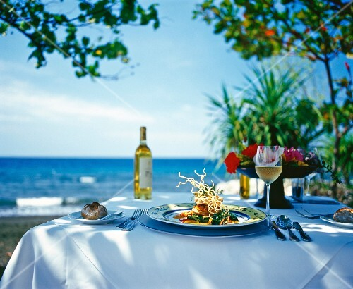 A table laid for a meal by the sea in Bali