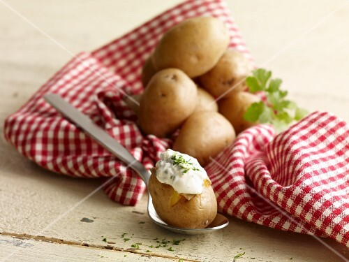 Oven-baked potatoes with herb dip