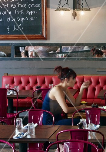 A woman eating in a Jamie's Italian restaurant in Cheltenham, England
