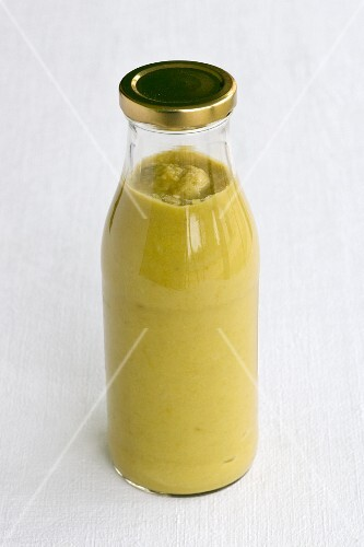 Green asparagus soup in a bottle