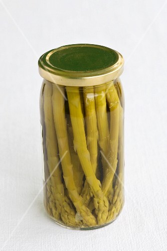 A jar of preserved green asparagus