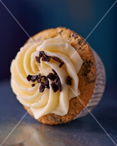 A cupcake topped with grated chocolate