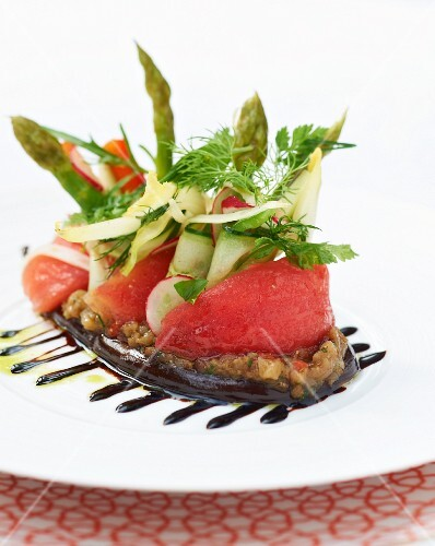 Tomatoes, cucumbers and asparagus on vegetable tartar
