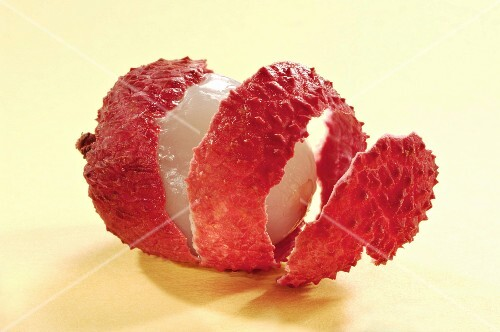A lychee, peeled in a spiral