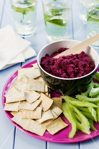 Beetroot dip with crisps and celery