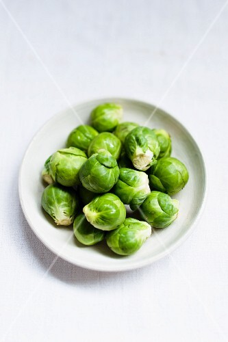 Brussels sprouts on a white plate