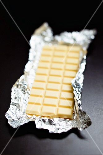 A bar of white chocolate in silver foil