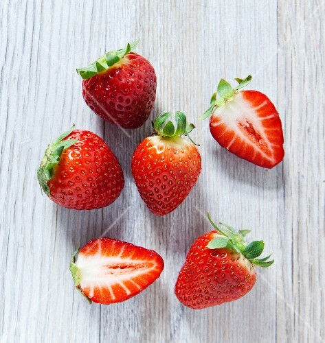 Strawberries on a wooden slab, viewed from above