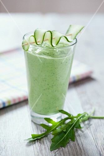 Rocket and cucumber smoothie on a wooden tabletop