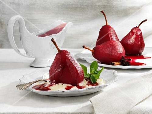 Red wine-poached pears on a bed of rice pudding