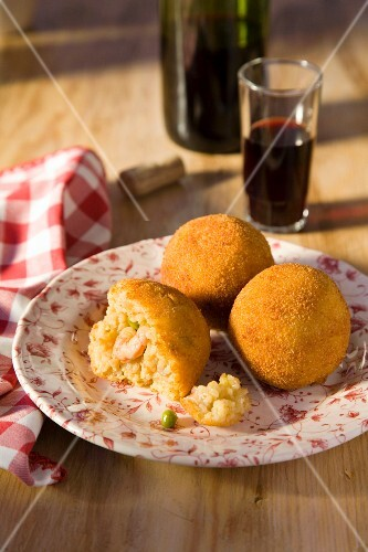 Arancini de paella (deep-fried rice balls with seafood, Spain)