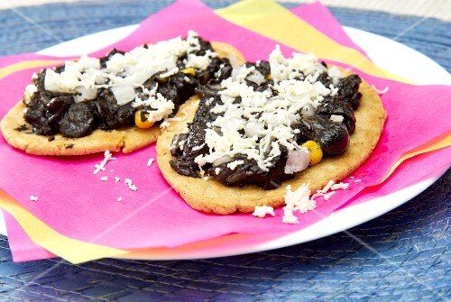 Tlacoyos (oval corn tortillas) with huitlacoche (corn fungus) and cheese (Mexico)