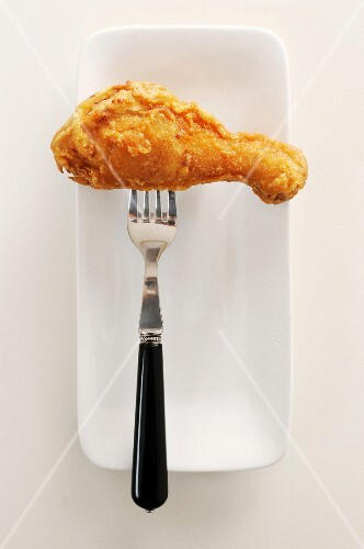 A Fried Drumstick on a Fork