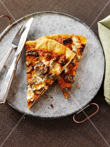 Two Slices of Mushroom Pizza with a Fork and Knife
