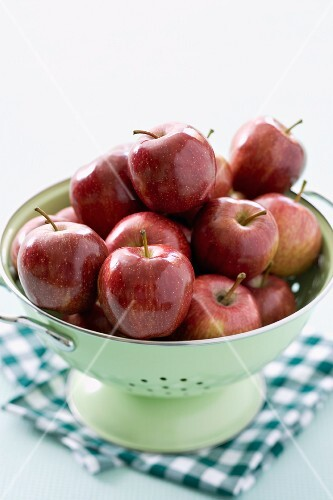 Lots of red apples in a colander
