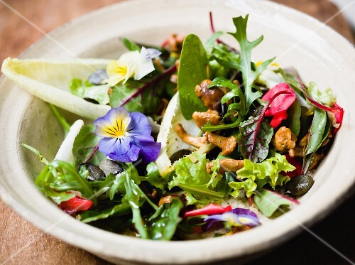 Mixed lettuce with edible flowers and chanterelle mushrooms