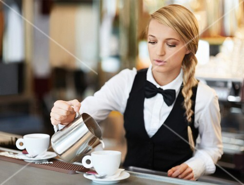 A waitress pouring coffee in a restaurant