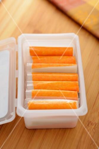 Surimi sticks in a plastic container