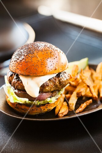 Hamburger with Mayo Sauce, Lettuce and Onion on a Poppy Seed Bun, Served with French Fries