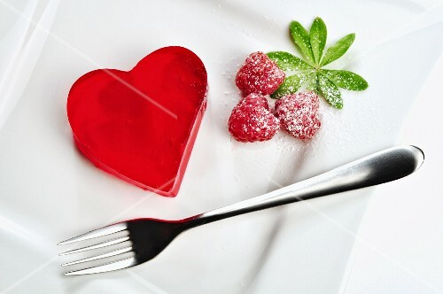 Heart shaped red jello dessert on a plate