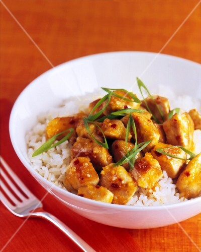 Orange Glazed Chicken with Scallions Over Jasmine Rice; In a White Bowl