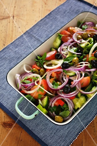 Mediterranean vegetable salad with tomatoes, cucumber, olives and onions