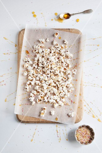 Party popcorn with honey and colourful sugar sprinkles