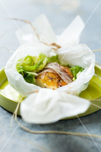 Haddock with bacon, wrapped in grease-proof paper