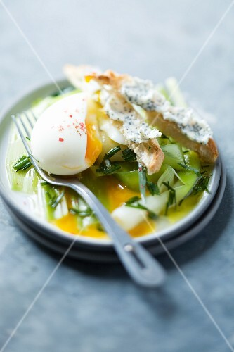A soft-boiled egg with leeks
