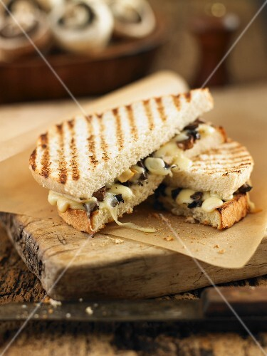 Toasted sandwiches with mushrooms and cheese