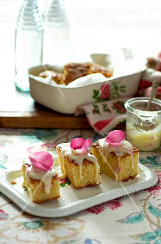 Almond cake with rose petals and sugar icing