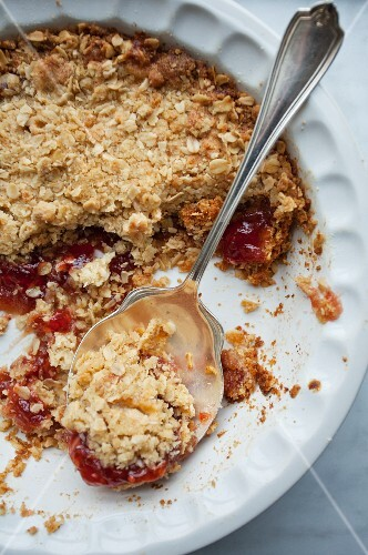 Strawberry jam topped with oat crumble in a casserole dish