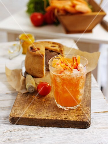 Orange drink with tomato and chilli