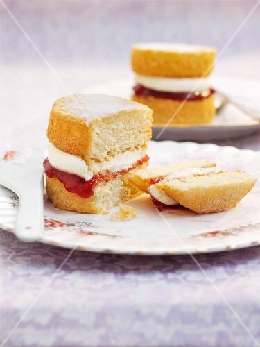 A mini Victoria Sponge cake (sponge cake with vanilla buttercream and strawberry jam)