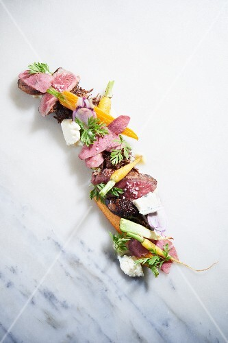 Beef Cheek, Parsnips, Pearl Onions, New York Strip Steak, Maytag Blue Cheese, Pickled Beef Tongue and Carrot Greens