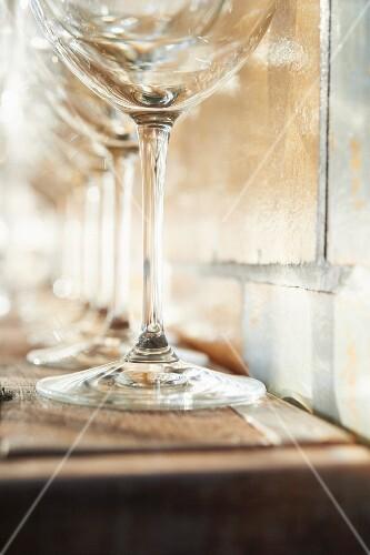 Empty Wine Glasses on a Shelf