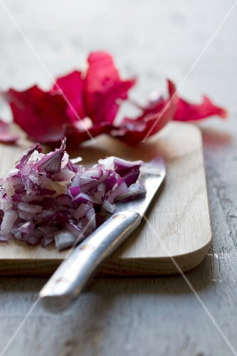 Chopped red onions on a chopping board