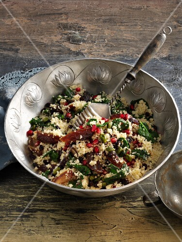 Couscous salad with spinach, dates and pomegranate seeds