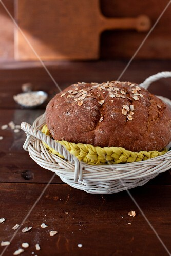 A Loaf of Homemade Oat Bread in a Basket
