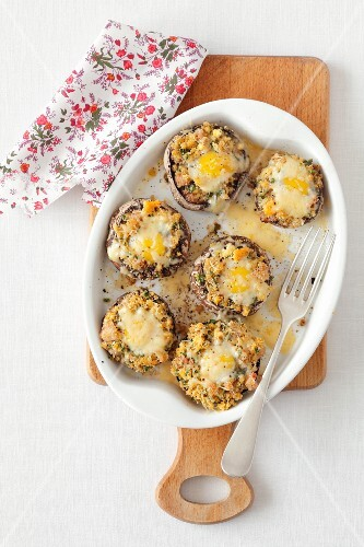 Stuffed mushrooms with bacon and quail's eggs