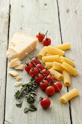 Pasta, tomatoes, oregano and Grana Padano cheese