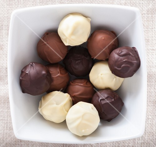 Assorted home-made chocolate truffles in a bowl