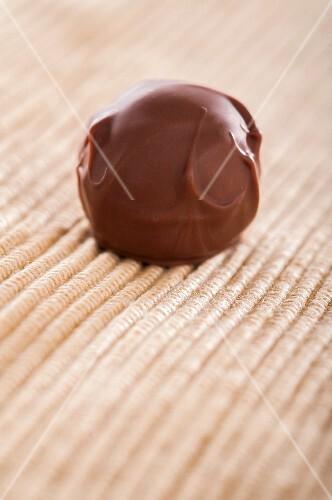 A home-made chocolate truffle coated in milk chocolate
