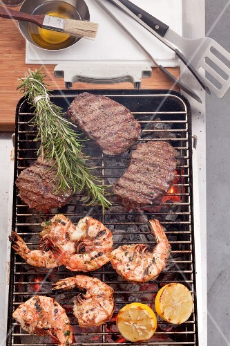 Grilled king prawns and steak on the barbecue grill