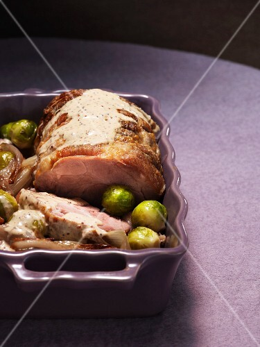 Roast pork with Brussels sprouts, shallots and a creamy sauce