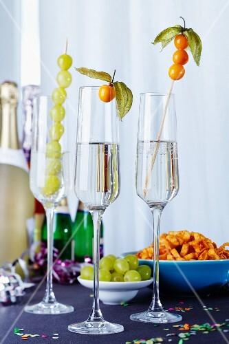 Fruit kebabs in champagne glasses