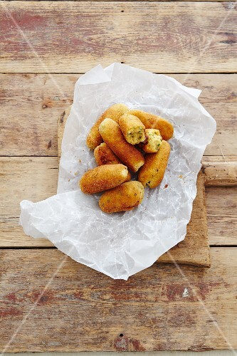 Chicken croquettes on paper
