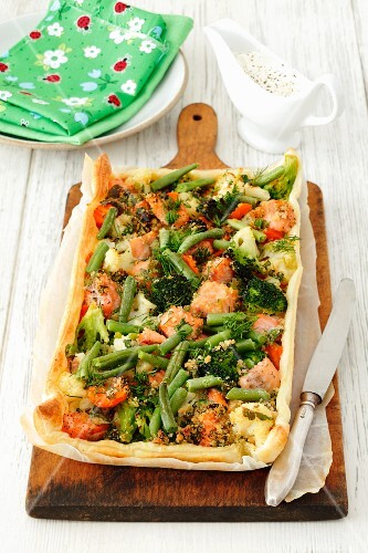 A cauliflower, broccoli, carrot and salmon tart