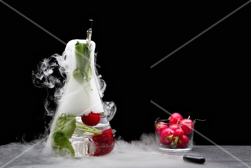 Radishes in a chemistry flask with dry ice